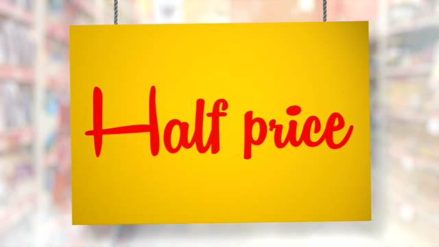 Half price sign hanging from ropes. Luma matte included so you can put your own background.