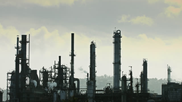 half silhouetted oil refinery - port of los angeles stock videos & royalty-free footage