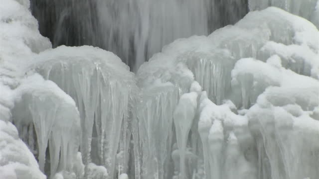 cu, half-frozen waterfall, aomori, japan - oirase river stock videos & royalty-free footage