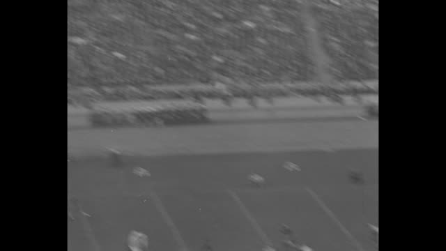 halftime show and fans in stands at los angeles memorial coliseum during college football game between university of southern california and the... - university of california bildbanksvideor och videomaterial från bakom kulisserna
