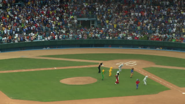 ws ha halftime show at baseball game / havana, cuba - mascot stock videos & royalty-free footage