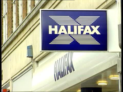 halifax/bank of scotland merger itn lib angle gv halifax branch la ms wall sign 'halifax' la ms wall sign 'bank of scotland' bv woman in plaid skirt... - plaid stock videos & royalty-free footage