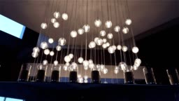 Hall of a hotel or restaurant, chandelier in the lobby, Chandelier hangs from the ceiling, creative, modern, interior, hotel or restaurant interior