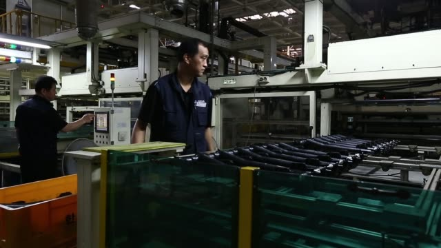 a halla visteon climate control corp employee puts a radiator tank into an assembly machine on the production line manufacturing vehicle heaters and... - aluminum sheet stock videos and b-roll footage