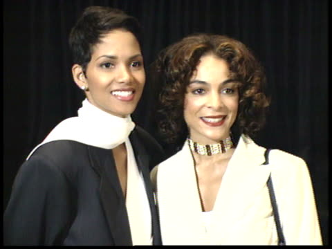halle berry and jasmine guy pose for paparazzi on red carpet - friars roast 1993 stock videos and b-roll footage
