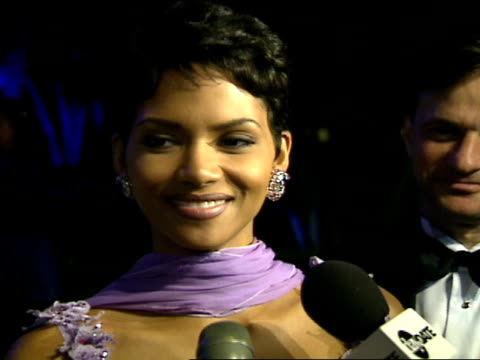 halle berry talks to reporters at the vanity fair oscar party. - oscar party stock videos & royalty-free footage