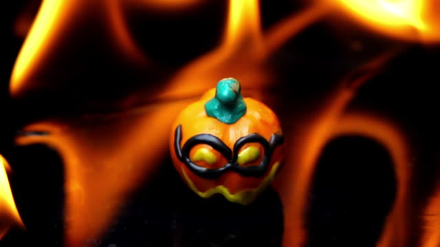halloween baby pumpkin burning on black background - interconnect plug stock videos & royalty-free footage
