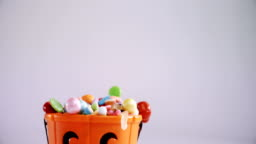 Halloween bucket filled up with various confectioneries 4k