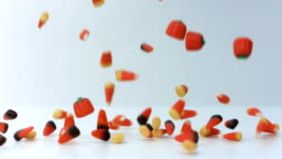 halloween candy falling in slow motion on white background