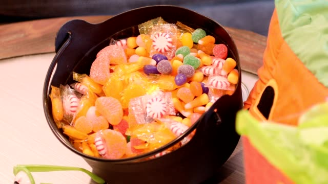 halloween candy on table with decorations. - confectionery stock videos & royalty-free footage