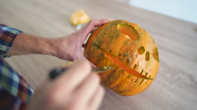 halloween carvings - carving knife stock videos and b-roll footage