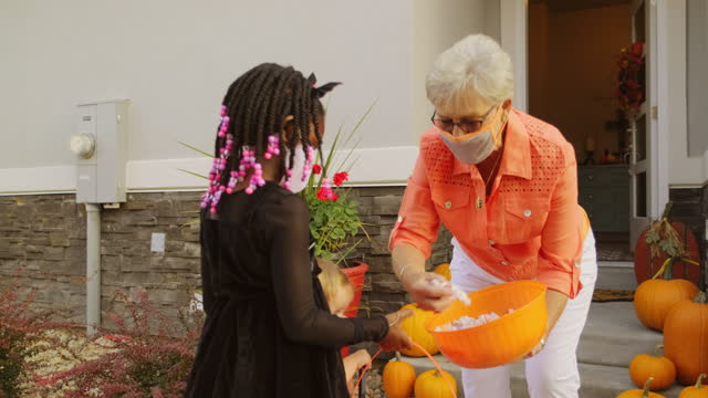 halloween children trick or treating wearing facemasks - cat family stock videos & royalty-free footage