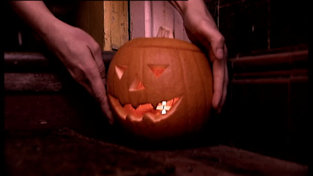 Council measures to prevent extreme behaviour ENGLAND London Waltham Forest Carved Halloween pumpking with candle inside placed on doorstep INT Door...