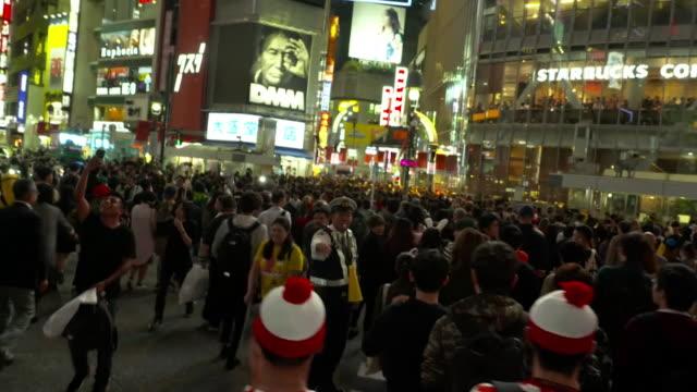 halloween festivities and people in costume in tokyo japan - bbc点の映像素材/bロール
