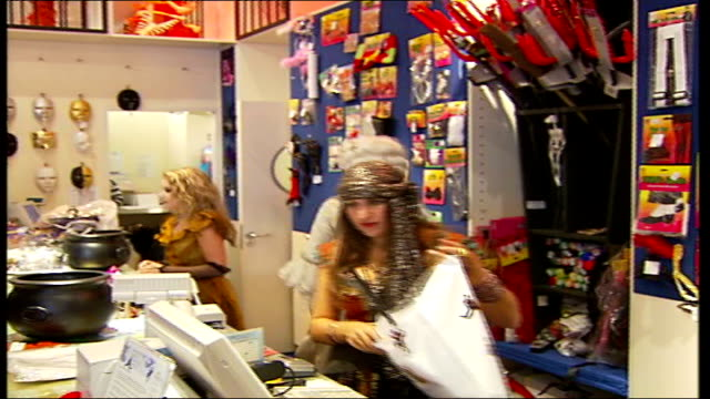 london costumier 'angels' has busiest night of the year high angle shot of customers in angels fancy dress shop woman in silver headgear putting... - marie antoinette stock videos and b-roll footage