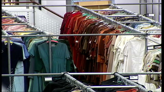 london costumier 'angels' has busiest night of the year pull focus angels fancy dress shop sign low angle shot of racks of costumes track shelves... - fancy dress costume stock videos and b-roll footage