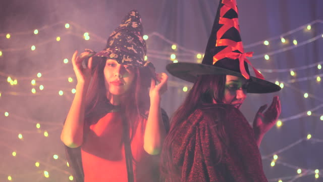 halloween party witch and she devil have fun with drinking - medical dressing stock videos & royalty-free footage