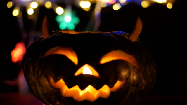 halloween pumkin bokeh light background - carving craft product stock videos & royalty-free footage