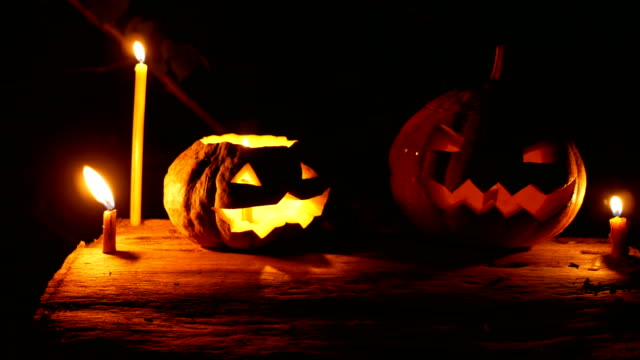 halloween pumpkin glowing in the dark - conceptual symbol stock videos and b-roll footage