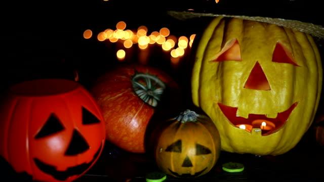 halloween pumpkin head jack lantern on wooden background - halloween wallpaper stock videos and b-roll footage