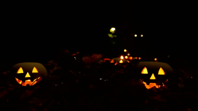 halloween pumpkin head jack lantern with autumn leafs - jack o' lantern stock videos and b-roll footage