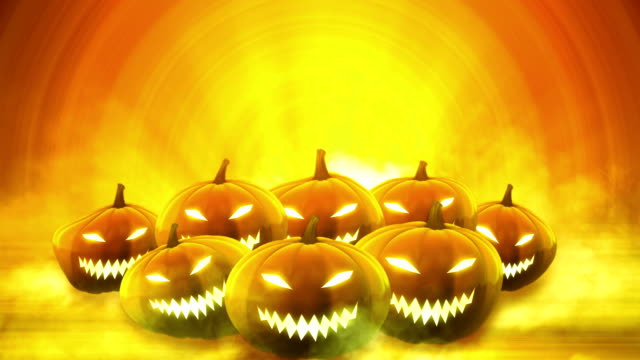 halloween pumpkins background - loop - brown stock videos & royalty-free footage