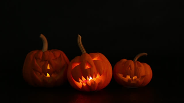 halloween pumpkins smile and scary eyes - interconnect plug stock videos & royalty-free footage
