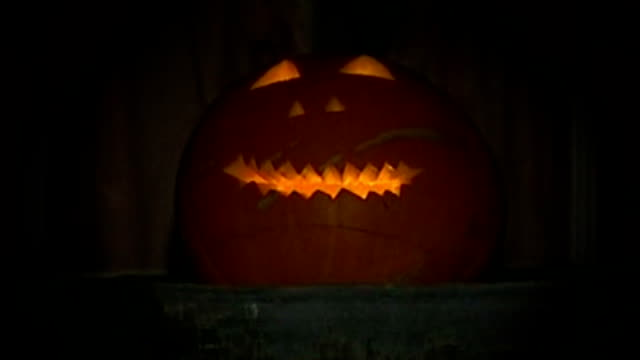 Trick or treat Police and council prevention measures ENGLAND Surrey Halloween pumpkin with 'glowing' moster face NIGHT Ends