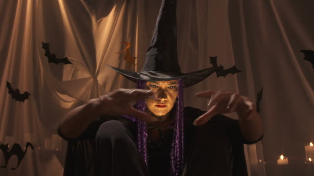 hd: halloween witch conjuring a spell - demon fictional character stock videos & royalty-free footage