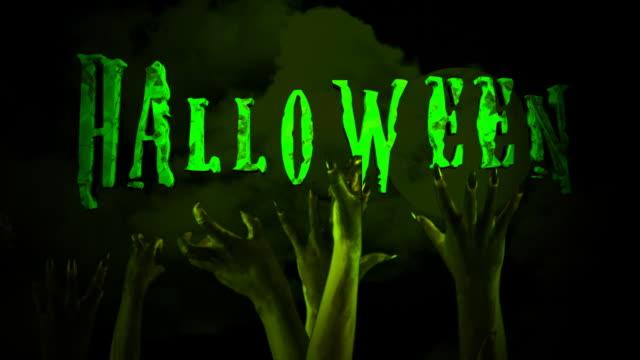 vídeos de stock, filmes e b-roll de halloween zombie mãos em alta definição - escrita ocidental