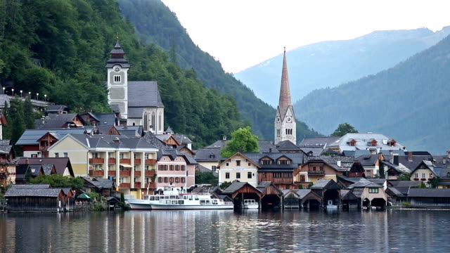 hallstatt village cityscape lake austria sunset - french culture stock videos & royalty-free footage