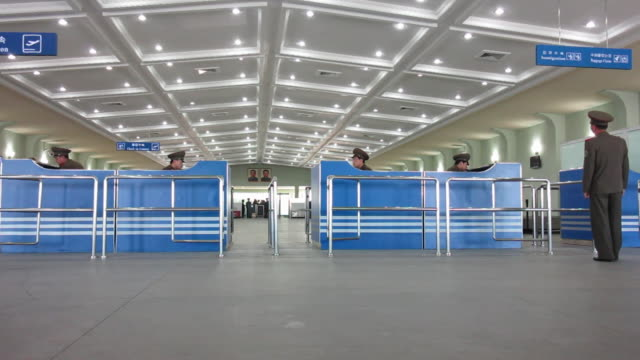A hallway separates office cubicles in the Pyongyang International Airport arrivals and departures Hall in Pyongyang.