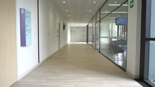 hallway view at the hospital - no people - clinica medica video stock e b–roll