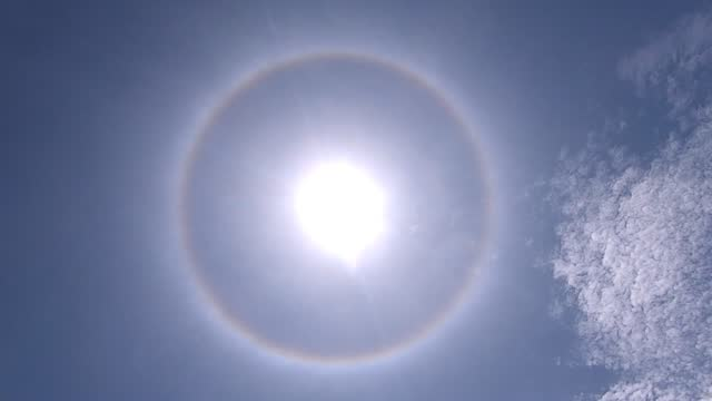 halo phenomenon around the sun spotted in seremban, malaysia. a halo is an optical phenomenon produced by light interacting with ice crystals... - sky stock videos & royalty-free footage