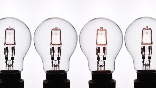 halogen light bulbs. - energy efficient lightbulb stock videos and b-roll footage