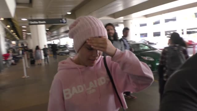 Halsey hides from paparazzi at Los Angeles International Airport at Celebrity Sightings in Los Angeles on August 05 2016 in Los Angeles California