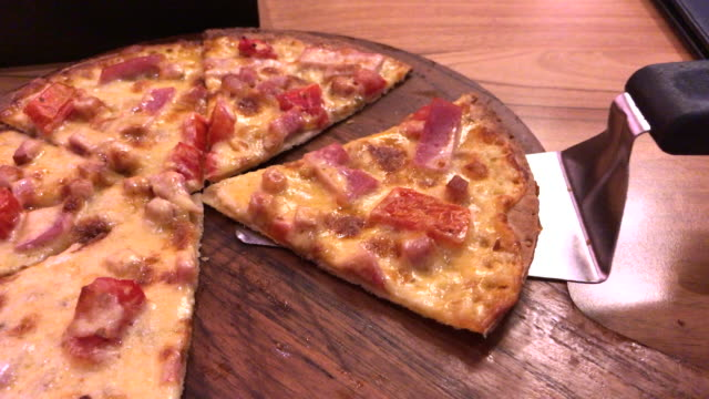 ham and bacon with extra cheese pizza , bangkok , thialand - muscle fiber stock videos and b-roll footage