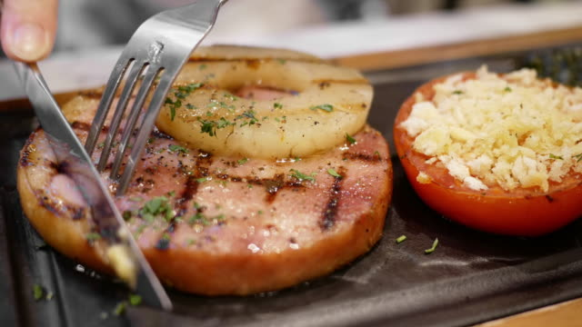 ham steak with pineapple and tomato - pineapple stock videos & royalty-free footage