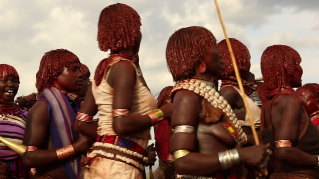 Hamar tribe during the Bull Jumping ceremony The young women are dancing and provocating the young men during the Whipping ritual Omo river Ethiopia