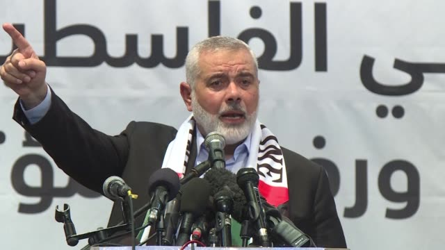 hamas leader in gaza ismail haniya attends a meeting in gaza city where he gives a speech denouncing and rejecting the usled peace to prosperity... - hamas stock videos & royalty-free footage