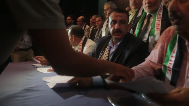 Hamas' MP and head of the parliament in Gaza City Ahmad Bahar and Palestinian MP Ashraf Jomaa MP Majed Abu Shamala attend a ceremony at which 14...
