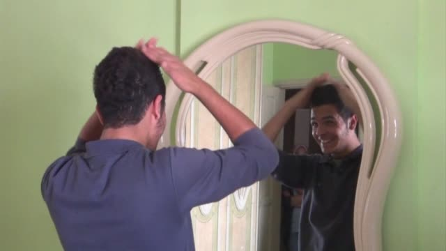 hamas security forces in gaza have been rounding up young men and forcing them to get haircuts on grounds of inappropriate hairstyles a rights group... - gaza city stock videos & royalty-free footage