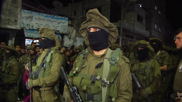 hamas' winged army ezzedine alqassam showed at a funeral for one of the human frogs in alburaij camp new weapons and heavy military equipment and a... - hamas stock videos & royalty-free footage