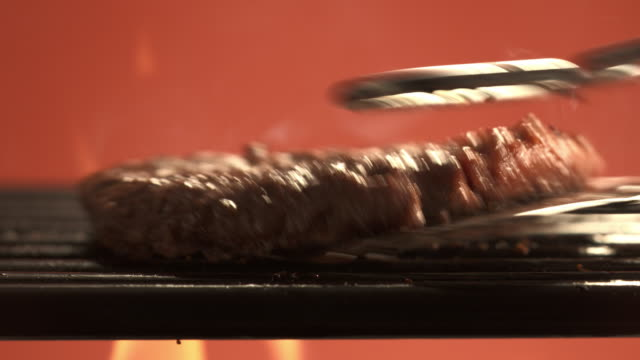 cu hamburger being grilled and flipped / los angeles, california, united states - meat stock videos & royalty-free footage