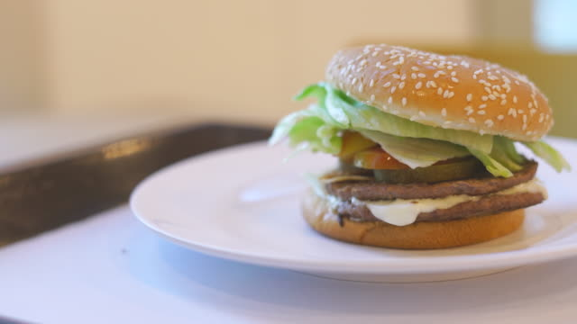 hamburger on white plate sliding shot - dolly shot stock videos & royalty-free footage