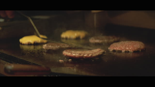 cu hamburgers being cooked on grill - hamburger stock videos & royalty-free footage