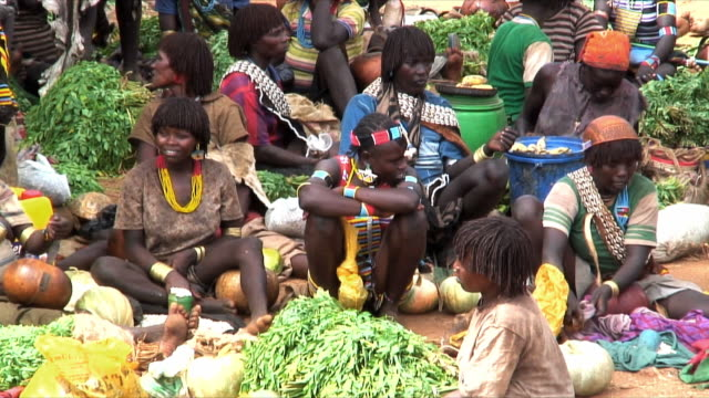 ms hamer tribe women on food market, omo river valley, ethiopia - ethiopia stock videos and b-roll footage