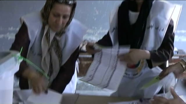 hamid karzai agrees to run-off presidential election; t20080905 kabul: female officials gathering up ballot papers - runoff election stock videos & royalty-free footage
