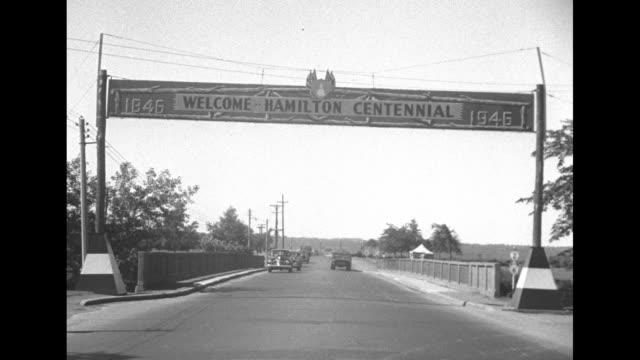 ws hamilton / street level shot of banner across street that says welcome hamilton centennial 1946 / shot of exterior of dundurn castle hamilton... - 100th anniversary stock videos & royalty-free footage