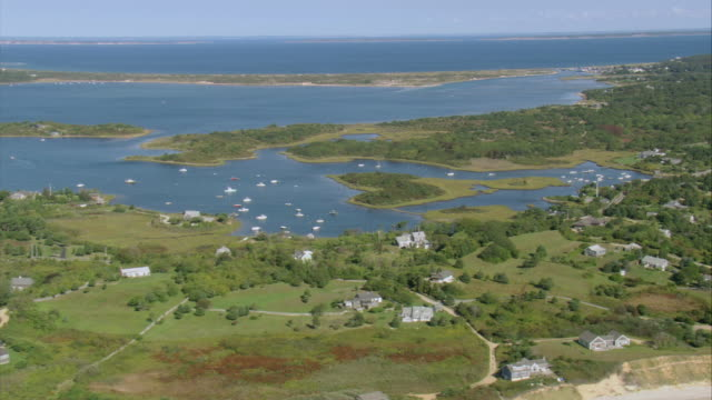 aerial hamlets dotted along jagged inlet coastline with islands and natural breakwater / aquinnah, massachusetts, united states - inlet stock videos & royalty-free footage
